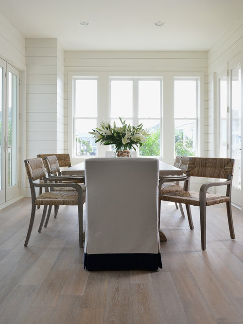 Nice Beach Style Beige Floor Dining Room Idea In Houston With White Walls