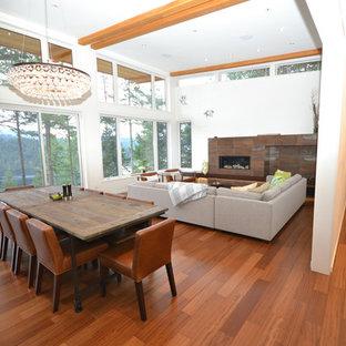 Foto de comedor contemporáneo, grande, abierto, con paredes blancas, suelo de madera oscura, chimenea lineal, marco de chimenea de baldosas y/o azulejos y suelo azul