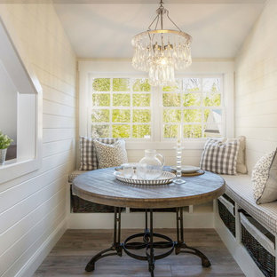 Inspiration for a small country dark wood floor enclosed dining room remodel in Atlanta with white walls