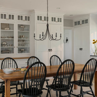 Example of a mid-sized country light wood floor and beige floor kitchen/dining room combo design in Bridgeport with gray walls and no fireplace