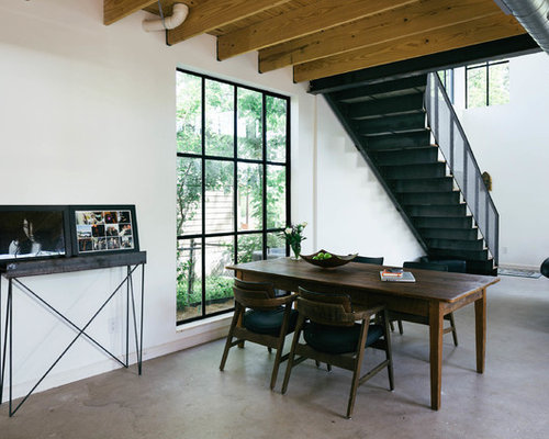 example of an urban great room design in austin with white walls and concrete floors