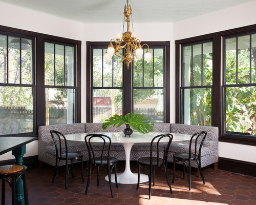 Example Of An Eclectic Brown Floor Kitchen Dining Room Combo Design In Austin With White