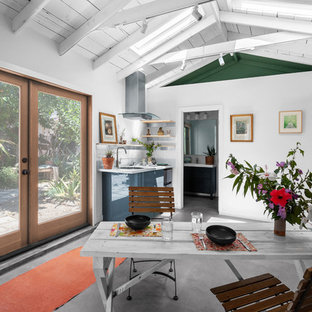 Example of a small beach style concrete floor and gray floor kitchen/dining room combo design in Los Angeles with white walls