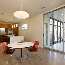 Contemporary Dining Room by Don Harris, Architect