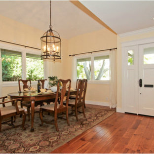 Example of a large classic medium tone wood floor great room design in San Francisco with yellow walls and no fireplace