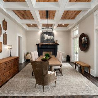 Idee per una sala da pranzo country con pareti beige, parquet scuro, camino classico, pavimento marrone e soffitto a cassettoni