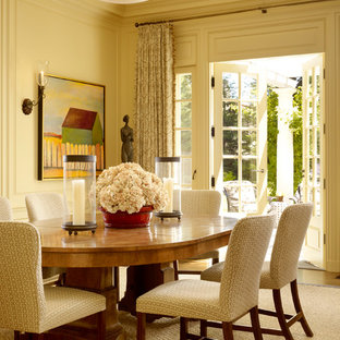 This is an example of a classic dining room in San Francisco with beige walls.