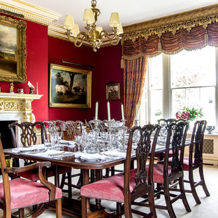 This Is An Example Of A Medium Sized Traditional Dining Room In London With Red Walls