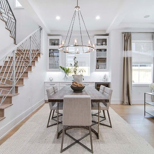 Inspiration for a mid-sized coastal light wood floor and beige floor dining room remodel in Orlando with white walls