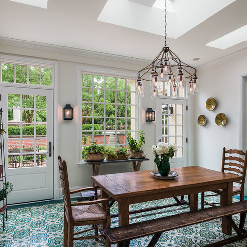 Example Of A Classic Multicolored Floor Enclosed Dining Room Design In Philadelphia With White Walls