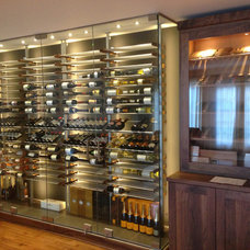 Contemporary Dining Room by Millesime wine racks