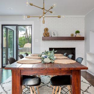 ローリーの大きいトランジショナルスタイルのおしゃれなダイニングキッチン (濃色無垢フローリング、茶色い床、白い壁、標準型暖炉、レンガの暖炉まわり) の写真