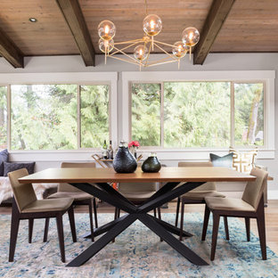 Inspiration for a small 1950s medium tone wood floor and brown floor kitchen/dining room combo remodel in Portland with gray walls and no fireplace