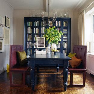 Example of a trendy dark wood floor dining room design in New York with beige walls