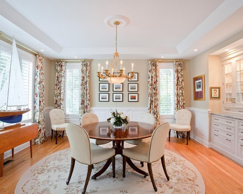 Inspiration for a mid-sized timeless enclosed dining room remodel in ...