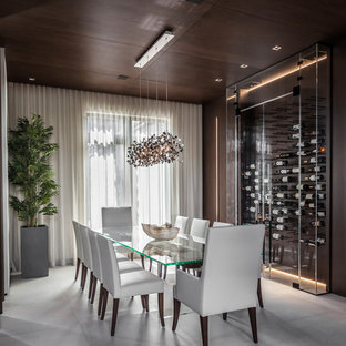 Enclosed dining room - large contemporary ceramic floor and gray floor enclosed dining room idea in Miami with white walls