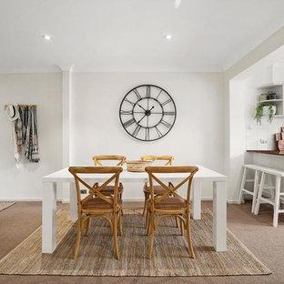 Photo of a scandinavian dining room in Sydney with beige walls, carpet and beige floor.