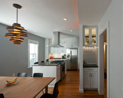 Example Of A Trendy Dark Wood Floor Kitchen/dining Room Combo Design In  Boston With