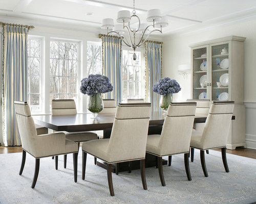 Transitional Medium Tone Wood Floor Dining Room Idea In New York With Beige  Walls