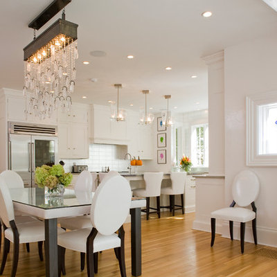 Example of a large classic medium tone wood floor great room design in New York with white walls and no fireplace