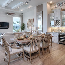Beach Style Dining Room by Divco Custom Homes