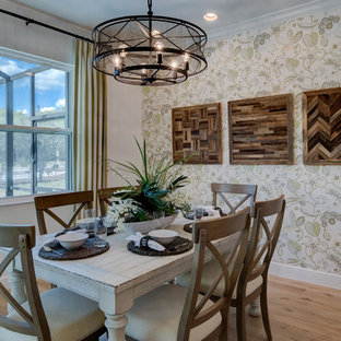 Transitional light wood floor and beige floor dining room photo with multicolored walls