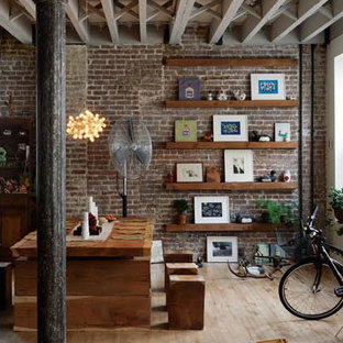 Mid-sized urban light wood floor great room photo in New York with brown walls and no fireplace