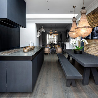 This is an example of a classic dining room in London with white walls, dark hardwood flooring, no fireplace and grey floors.