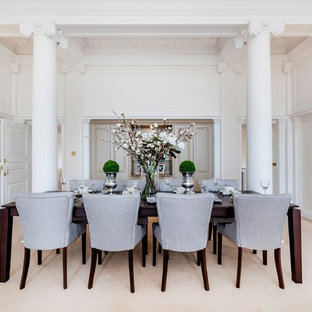 Traditional dining room in London with white walls, carpet and beige floors.