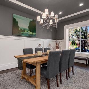 Ejemplo de comedor de estilo americano, de tamaño medio, cerrado, sin chimenea, con paredes grises y suelo de madera oscura