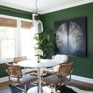 Photo of a mid-sized eclectic dining room in Perth with green walls, dark hardwood floors and brown floor.