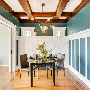 Example of an arts and crafts medium tone wood floor dining room design in Seattle with multicolored walls