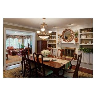 Ispirazione per una sala da pranzo tradizionale chiusa e di medie dimensioni con pareti beige, parquet scuro e cornice del camino in mattoni