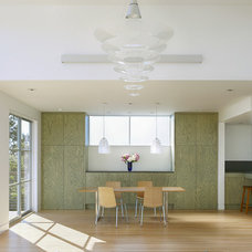 Contemporary Dining Room by Jetton Construction, Inc.