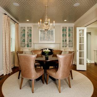Idee per una sala da pranzo tradizionale con pareti beige, parquet scuro e camino classico