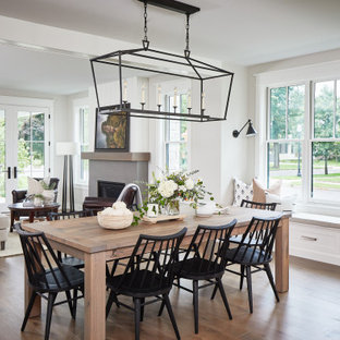 Great room - mid-sized farmhouse medium tone wood floor great room idea in Grand Rapids with white walls, a standard fireplace and a concrete fireplace