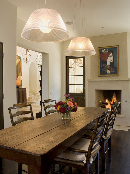 Inspiration For A Rustic Dining Room Remodel In Austin With White Walls Dark Wood Floors