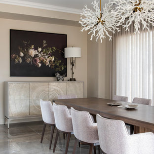 Photo of a contemporary dining room in Melbourne with beige walls and grey floor.