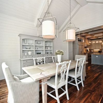 Enclosed dining room - mid-sized country dark wood floor enclosed dining room idea in Charlotte with white walls