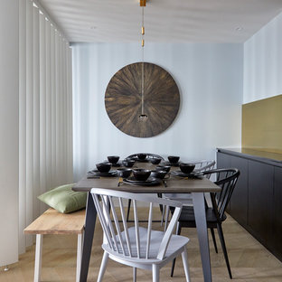 Inspiration for a medium sized contemporary dining room in London with blue walls, light hardwood flooring and beige floors.
