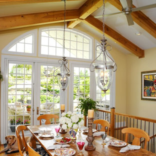 Dining room - traditional medium tone wood floor dining room idea in Denver with yellow walls