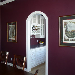 Design ideas for a mid-sized traditional separate dining room in Milwaukee with purple walls and light hardwood floors.