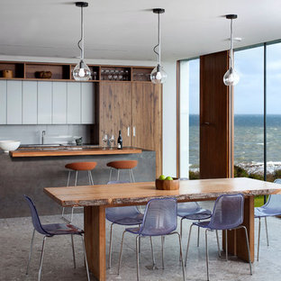 Medium sized contemporary open plan dining room in Belfast with grey floors.