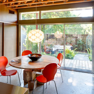Example of a trendy dining room design in Dallas with brown walls