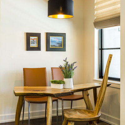 Example of a small transitional dark wood floor and brown floor dining room design in Albuquerque with beige walls