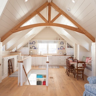 Example of a mid-sized beach style medium tone wood floor great room design in Boston