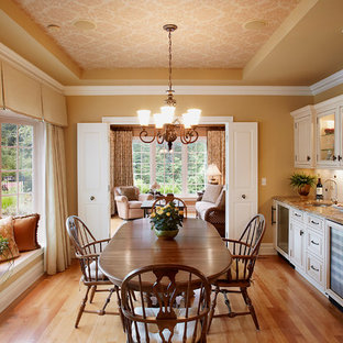 Inspiration for a timeless medium tone wood floor dining room remodel in New York