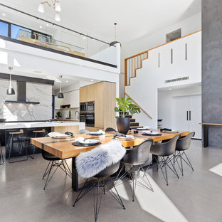 Design ideas for a contemporary open plan dining in Brisbane with concrete floors, grey floor and grey walls.