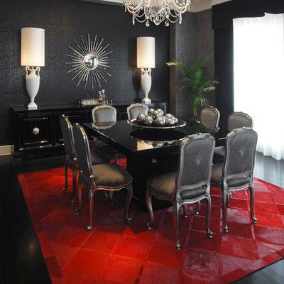 Example of a trendy black floor dining room design in Atlanta with black walls