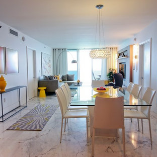 Inspiration for a contemporary marble floor dining room remodel in Miami with white walls